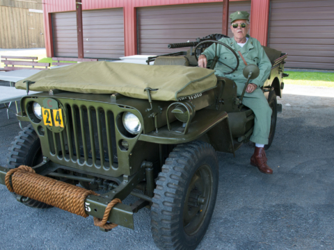Army jeep and officer